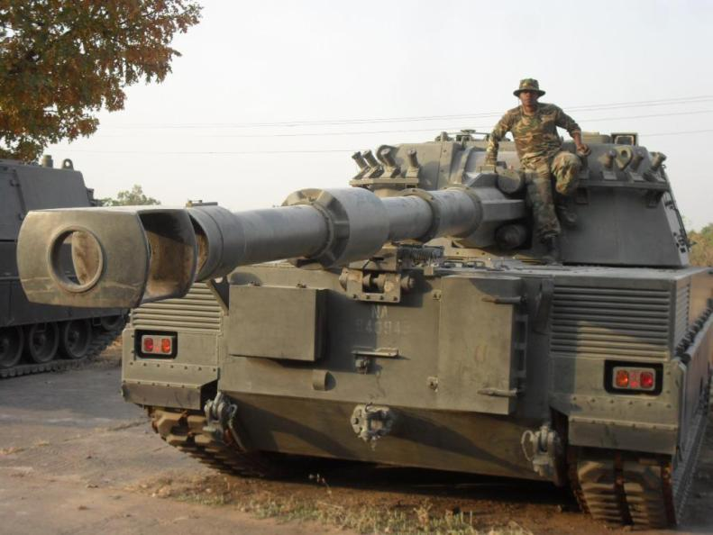 A Nigerian soldier sits atop a Palmaria 155 SPH.